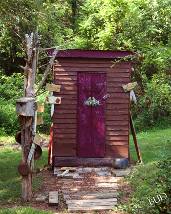 Fancy Privy -- Fancy Privy behind log cabin located next to Mattingly Funeral Home in Loretto in Marion County, KY <br>16 X 20 $85.00